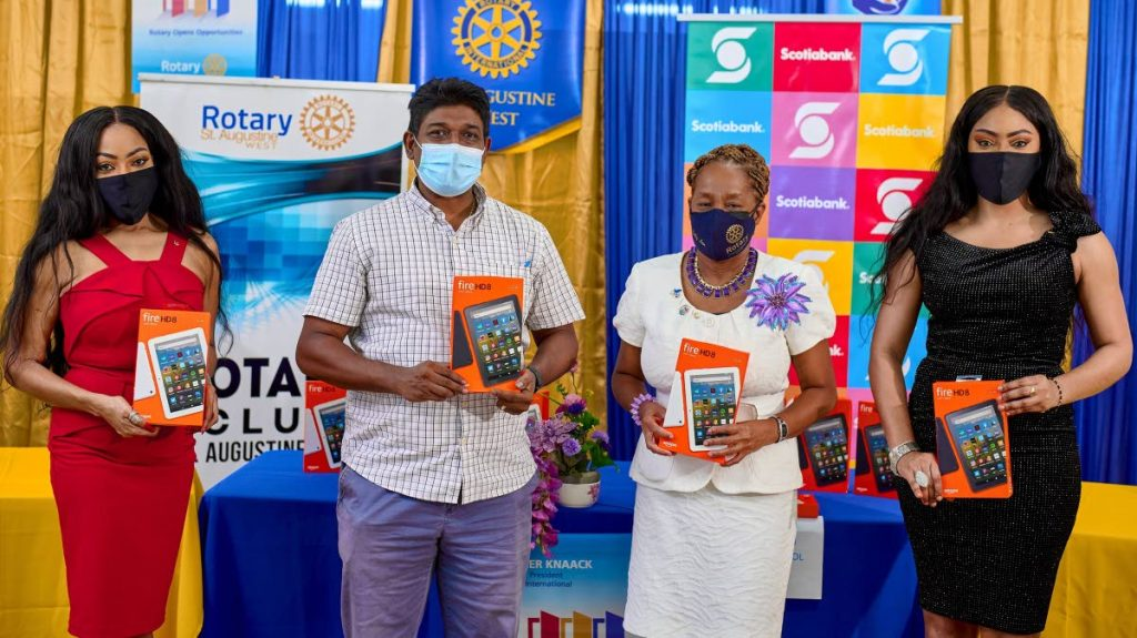 School representatives display devices donated through a partnership between the Rotary Club of St Augustine West and Scotiabank. PHOTO COURTESY SCOTIABANK  -