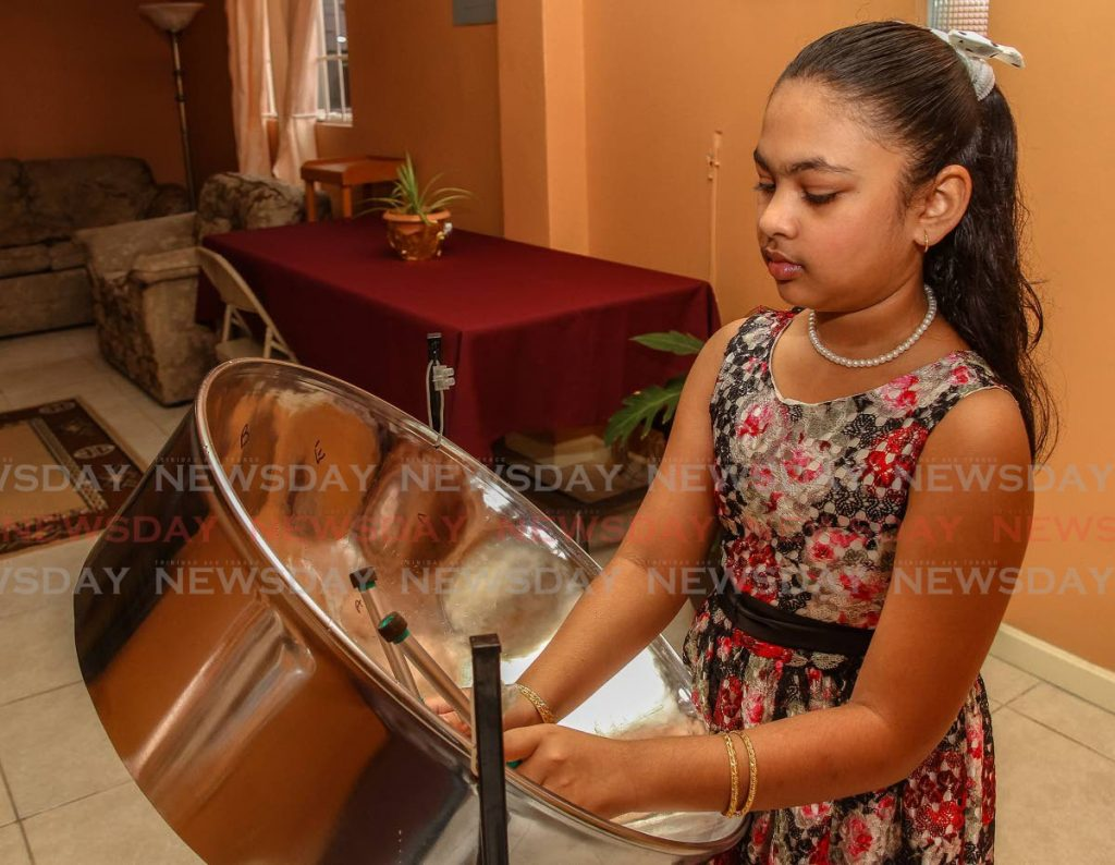 Lasara Kalloo concentrates on get the notes write playing the tenor pan. -