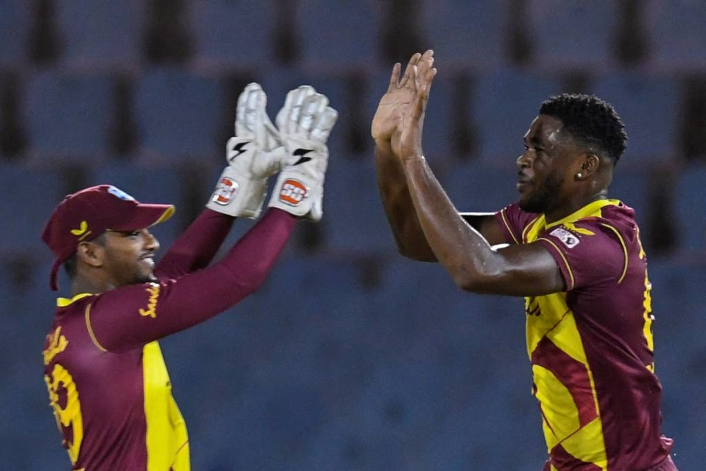 Pace bowler Obed McCoy (right) and stand-in captain Nicholas Pooran of the West Indies celebrate the dismissal of Ashton Agar of Australia during the 1st T20I between Australia and West Indies at the Darren Sammy Cricket Ground, Gros Islet, Saint Lucia, on Friday. (AFP PHOTO) -
