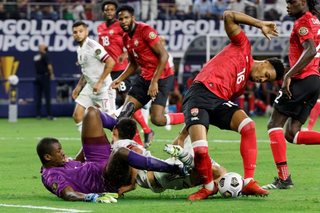 Action in the TT-Mexico Concacaf Gold Cup soccer match in Arlington, Texas, on Saturday. AP PHOTO - Michael Ainsworth