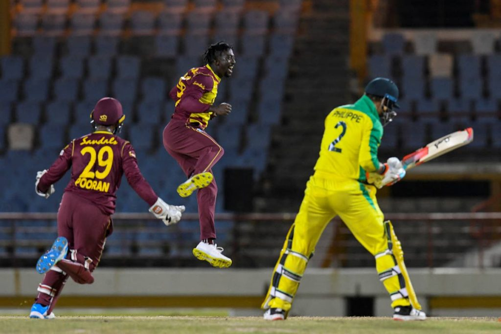 Hayden Walsh Jr. (centre) of West Indies celebrates the dismissal of Josh Philippe (right) of Australia during the 2nd T20I between Australia and West Indies at the Darren Sammy Cricket Ground, Gros Islet, St Lucia, on Saturday. Also in photo is stand-in West Indies captain Nicholas Pooran. (AFP PHOTO) -