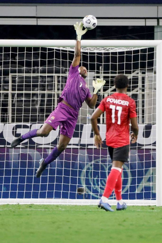 Trinidad and Tobago goalkeeper Marvin Phillip (1) makes a save from a shot by Mexico in front of defender Noah Powder during the second half of a Concacaf Gold Cup Group A match in Arlington, Texas, on Saturday. (AP Photo) -