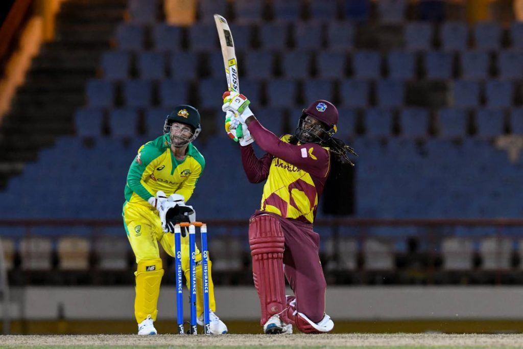 West Indies batsman Chris Gayle hits a six as Australia wicketkeeper Matthew Wade (left) watches during the 3rd T20 International between Australia and West Indies at the Darren Sammy Cricket Ground, Gros Islet, St Lucia, on Monday. (AFP PHOTO) -
