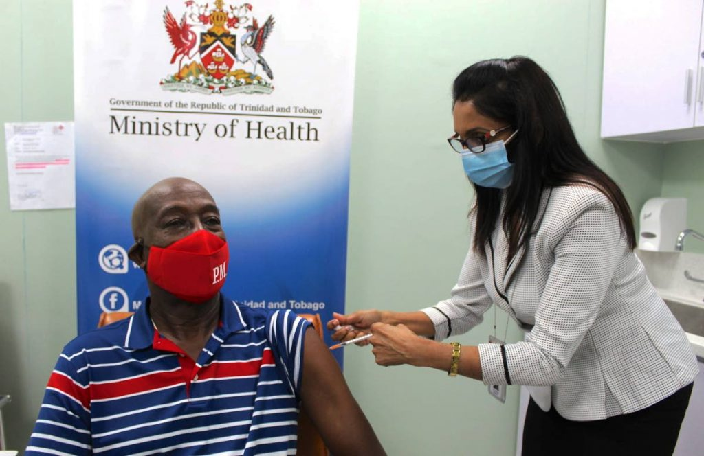 JABBED: Prime Minister Dr Keith Rowley receives his first dose of the Sinopharm covid19 vaccine on Tuesday at the Diego Martin Health Centre. PHOTO COURTESY OFFICE OF THE PRIME MINISTER -
