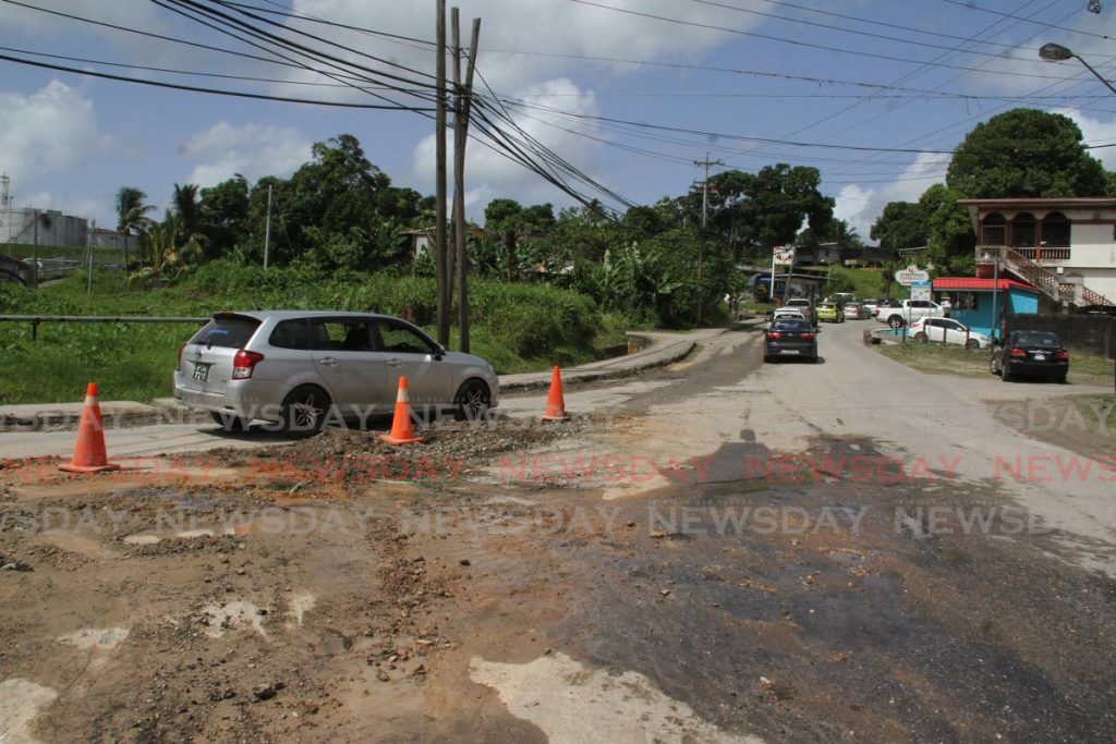 Completion of the repair of the Guapo/Cap-de-Ville Main Road, Port Fortin has been delayed until next Thursday. - Photo by Angelo Marcelle