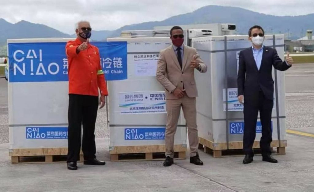 From left: Health Minister Terrence Deyalsingh, Foreign and Caricom Affairs Minister Dr Amery Browne and Chinese Ambassador to TT Fang Qiu with a shipment of 800,000 Sinopharm vaccines that arrived at the Piarco International Airport on Tuesday from China. PHOTO COURTESY AMBASSADOR FANG QIU'S FACEBOOK PAGE -