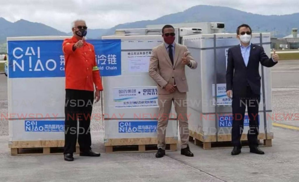 Arrival of the 800,000 Sinopharm vaccines to TT. From left are Health Minister Terrence Deyalsingh, Foreign and Caricom Affairs Minister Dr Amery Browne, and China's ambassador to TT, Fang Qiu. -
