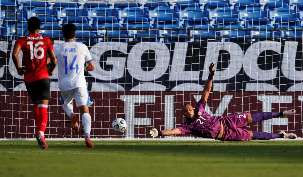 In this file photo, TT goalkeeper Nicklas Frenderup (21) is unable to stop a shot on goal from El Salvador midfielder Jairo Henriquez, not pictured, during a 2021 Concacaf Gold Cup Group A match, on Wednesday, in Frisco, Texas. TT face Guatemala, on Sunday, in their final group A match. Photo courtesy AP