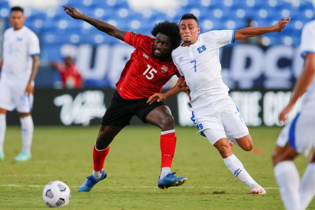 TT midfielder Neveal Hackshaw (15) and El Salvador midfielder Darwin Ceren (7) battle for the ball during a 2021 Concacaf Gold Cup Group A match,on July 14, in Frisco, Texas.  (AP Photo) -