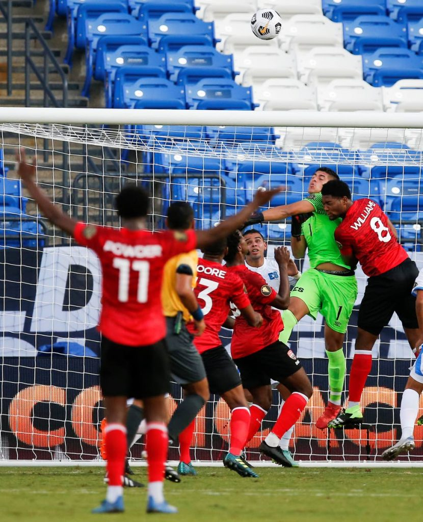 El Salvador goalkeeper Mario Gonzalez (1) punches the ball away during a 2021 CONCACAF Gold Cup Group A soccer match against Trinidad, Wednesday, July 14, 2021, in Frisco, Texas. El Salvador won 2-0. (AP Photo/Brandon Wade) -