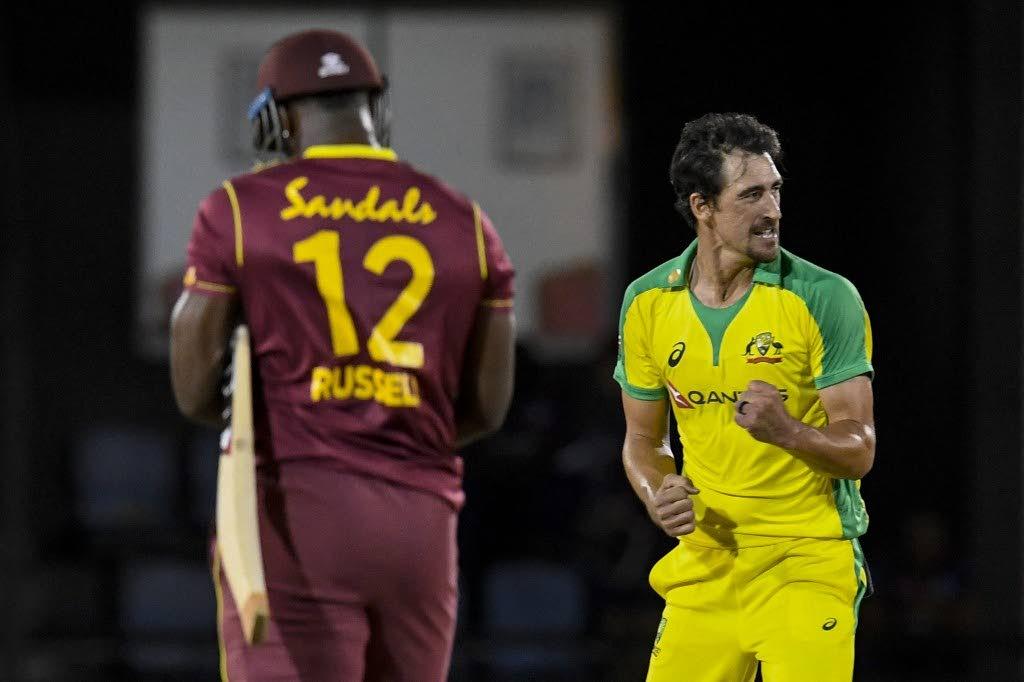 Mitchell Starc (R) of Australia celebrates winning the 4th T20I between Australia and West Indies at Darren Sammy Cricket Ground, Gros Islet, Saint Lucia, on Wednesday night.  - (AFP PHOTO)