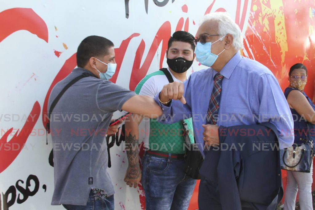 Health Minister Terrence Deyalsingh greets people waiting to receive the Sinopharm covid19 vaccine at the Paddock, Queen's Park Savannah, Port of Spain on Friday. On Saturday, Deyalsingh said people can now be vaccinated for free at private hospitals. - Photo by Marvin Hamilton