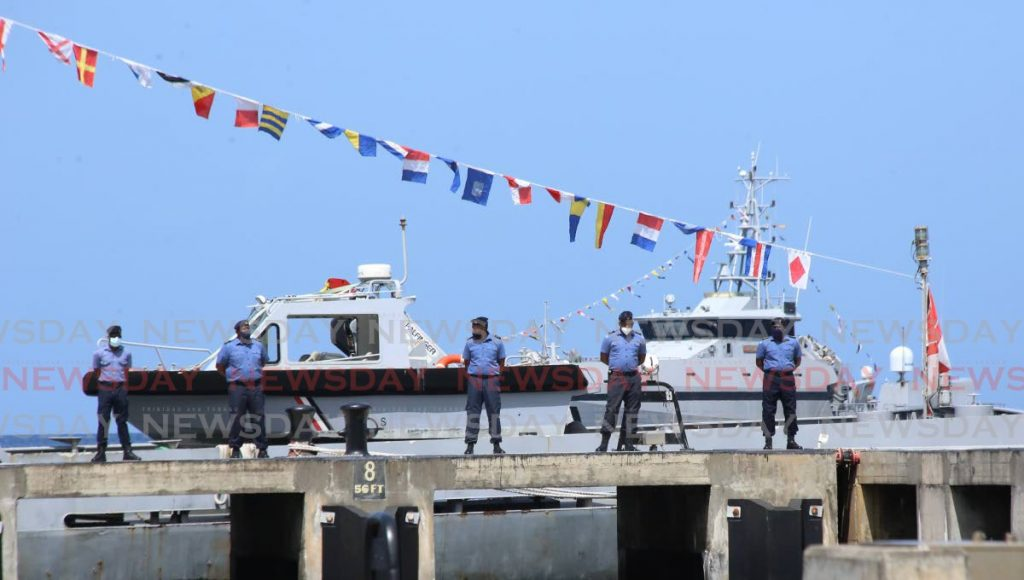 Coast Guard officers on the jetty at Stauble Bay, Chaguaramas. - Photo by Sureash Cholai