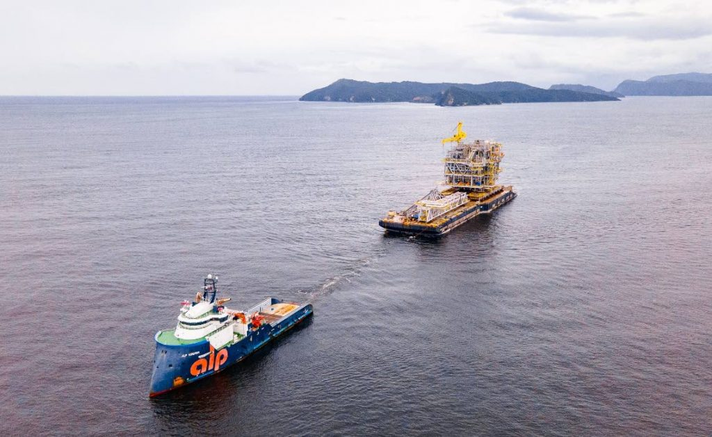 A tug leads the bpTT's Cassia C platform into the Gulf of Paria after it arrived in Trinidad from Mexico on Tuesday. - Photo courtesy bpTT
