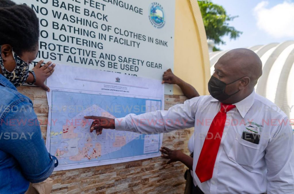 Curtis Douglas, president of the All-Tobago Fisherfolk Association, points to a map allegedly showing where BHP Trinidad will be doing a geotechnical survey. He spoke to the media on Friday at Pigeon Point, Tobago. - Photo by David Reid