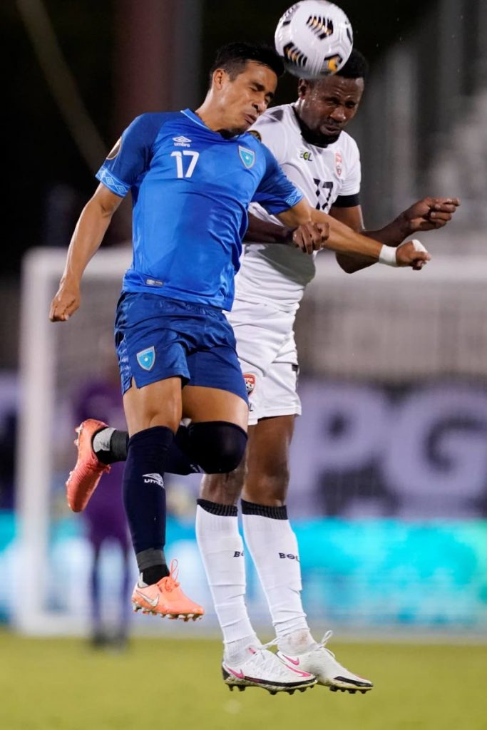 Guatemala forward Luis Martinez, left, and TT defender Justin Garcia, right, compete to control the ball in the second half of a Concacaf Gold Cup Group A, Round 3 match, on Sunday, in Frisco, Texas.  The maych ended 1-1. (AP Photo) -