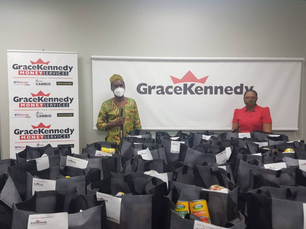 Grace Kennedy operations manager, Paulette Garcia with Kenneth  Suratt, executive officer at TT Blind Welfare Association (TTBWA). Grace Foods Latin America and the Caribbean and GraceKennedy Money Services (TT) jointly undertook the donations to the the TTBWA. -