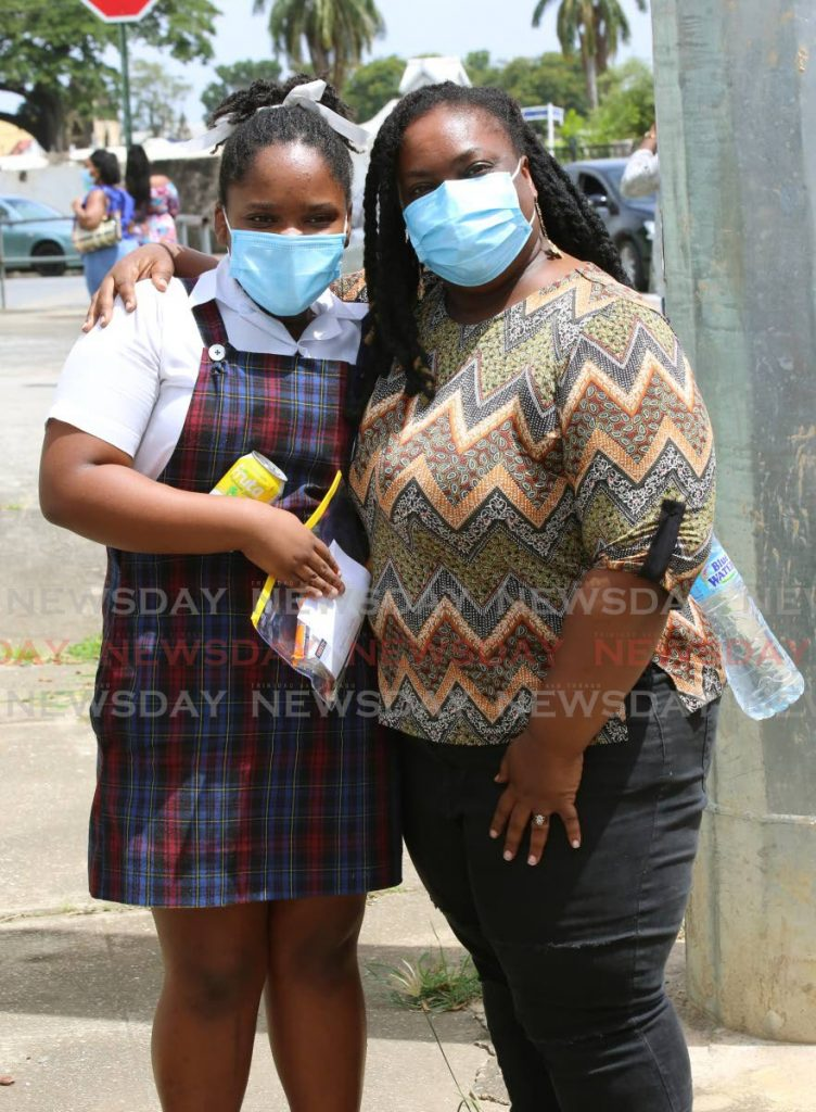 Ayomi Charles was met by her mother Malika Dunbar-Charles after writing Wednesday's SEA make-up exam at the Tranquillity Government Primary School on Stanmore Avenue, Port of Spain. - Sureash Cholai