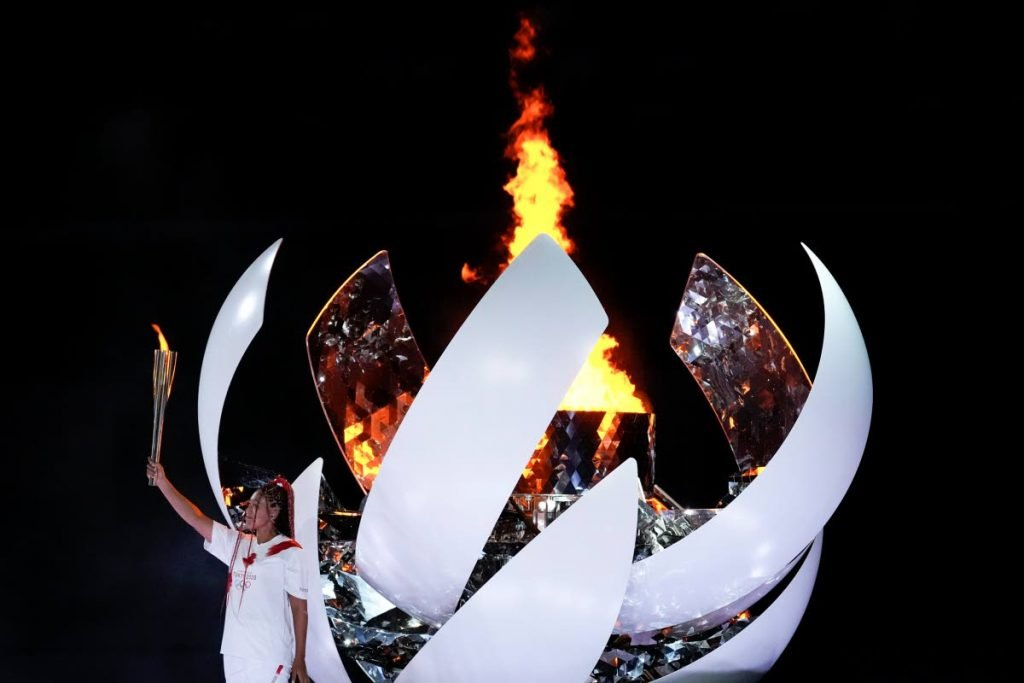 Japan's tennis star Naomi Osaka reacts after lighting the cauldron during the opening ceremony in the Olympic Stadium at the 2020 Summer Olympics, Friday, in Tokyo, Japan. (AP) -