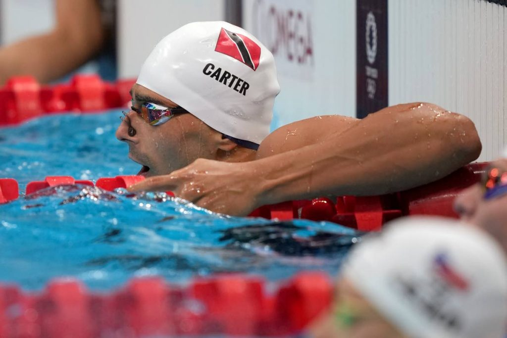 Dylan Carter of Trinidad and Tobago rests after his heat of the men's 100-metre backstroke at the 2020 Summer Olympics, on Sunday, in Tokyo, Japan. (AP PHOTO) -