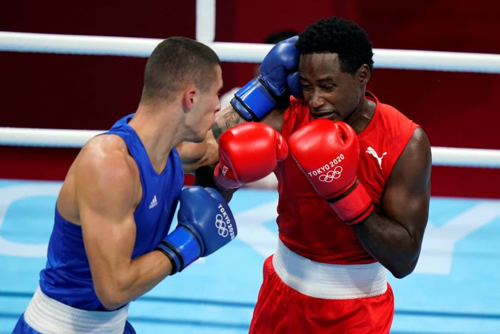 Andrej Csemez, of Solvakia, left, attacks Aaron Solomon Prince of Trinidad and Tobago, during their middle weight (75kg) preliminary boxing match at the 2020 Summer Olympics, Monday,  in Tokyo, Japan. (AP Photo) -