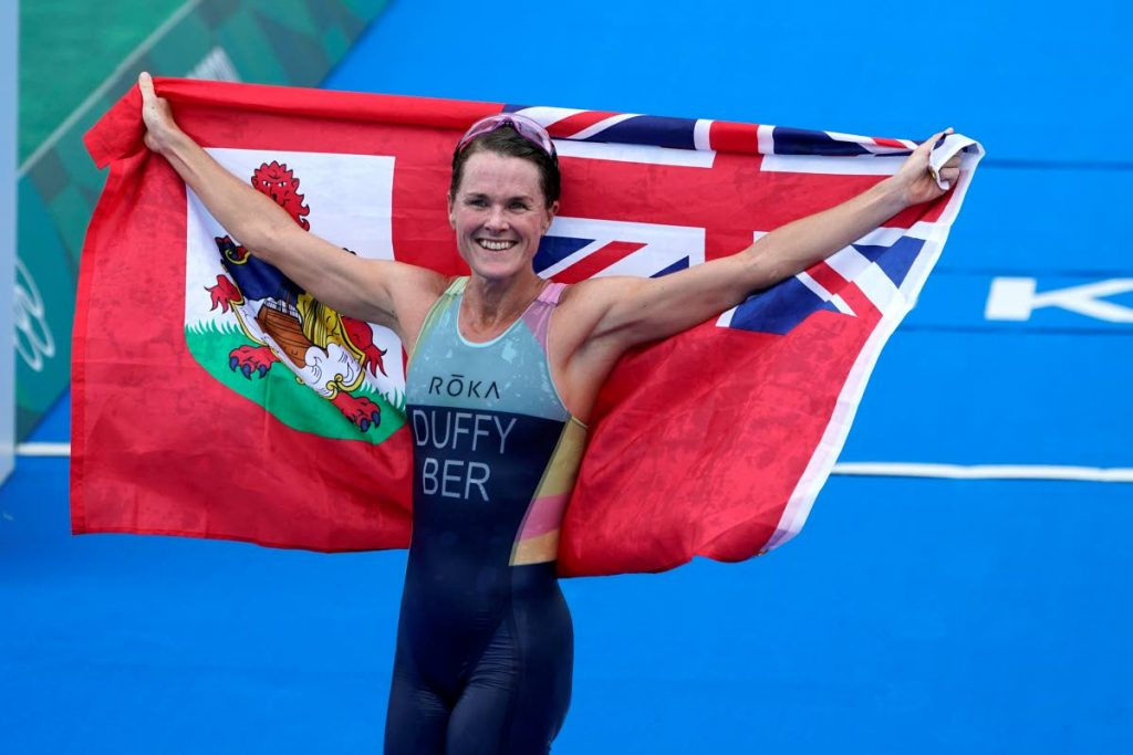 Gold medallist Flora Duffy of Bermuda celebrates after winning the women's individual triathlon competition at the 2020 Summer Olympics, on Tuesday, in Tokyo, Japan. (AP PHOTO) -