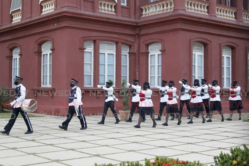 A police honour guard performs a march past at the Red House during a ceremony in which President Paula-Mae Weekes and other officials laid wreaths in memory of the victims of the July 27, 1990 attempted coup at the Cenotaph on Knox Street, Port of Spain, Tuesday. - ROGER JACOB