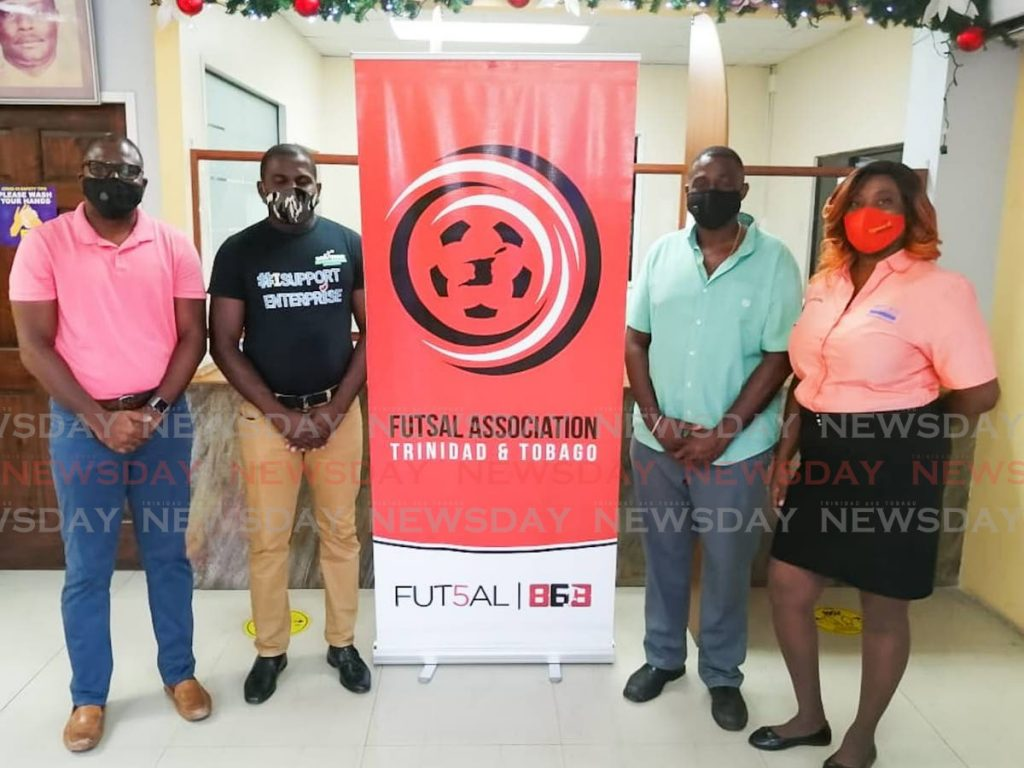 FOR THE CHILDREN: Futsal868 Kids' Connect partners from left,  FATT president Geoffrey Edwards, Dass Trace Youth Empowerment Committee member Justin Lewis, Enterprise businessman Sean Regis of Worrell A. Regis & Co. Ltd and chairman of the Jimroy Wyse Committee Ginelle Small-Cummings. -