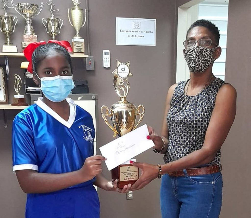 Young artist and ten-12 art category winner, Destiny Mansook of Mayaro (S. Thomas) RC, collects her trophy from Arvolon Wilson-Smith of The Black Deer Foundation. -
