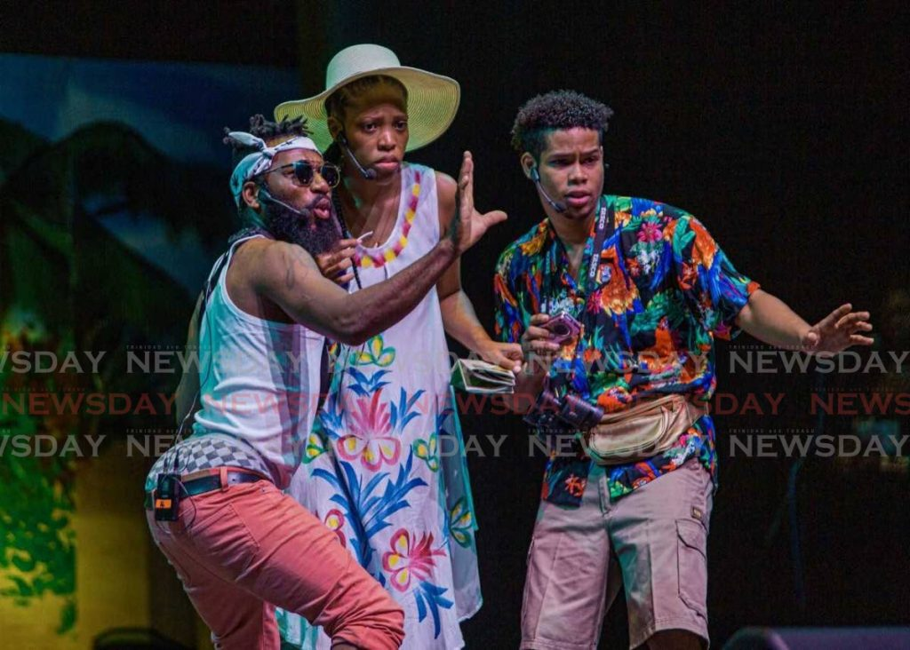 FILE PHOTO: Anton Roberts, left, acts as Eric, a tour guide who takes American visitors, played by Britni Brooks, centre, and Daniel Perreira, on a tour of Tobago, during the opening of the 2019 Tobago Heritage Festival at Shaw Park.   -