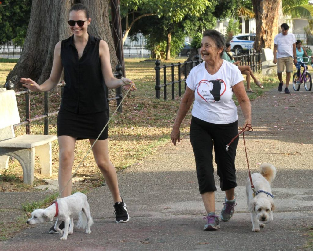 In this file photo, women laugh as they walk around the Queen's Park Savannah, Port of Spain with their dogs. In this file photo, women laugh as they walk around the Queen's Park Savannah, Port of Spain with their dogs. Dr Shevon Joseph, medical director and consultant physician at Azalea Health Services, says regular exercise, at least three times weekly is a great way to help ease perimenopause symptoms such as hot flashes and night sweats. - Photo by Ayanna Kinsale