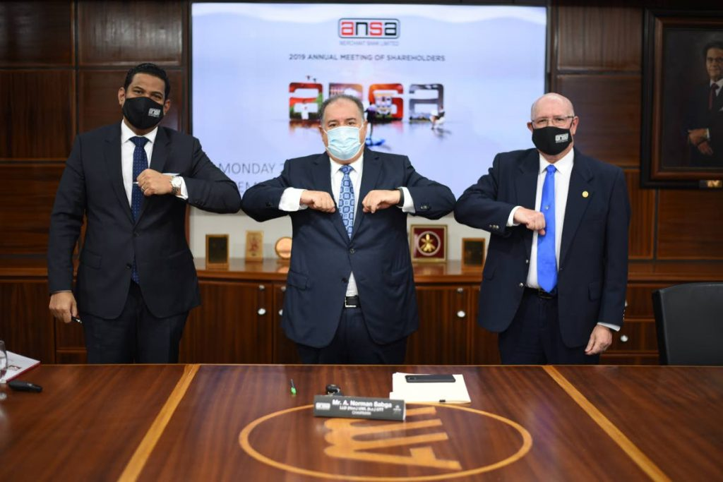 Ansa Merchant Bank chairman A Norman Sabga (centre) knocks elbows with managing director Gregory Hill (left) and corporate secretary Robert Ferreira at the 2019 annual meeting of shareholders held virtually on September 28, 2020. File photo -