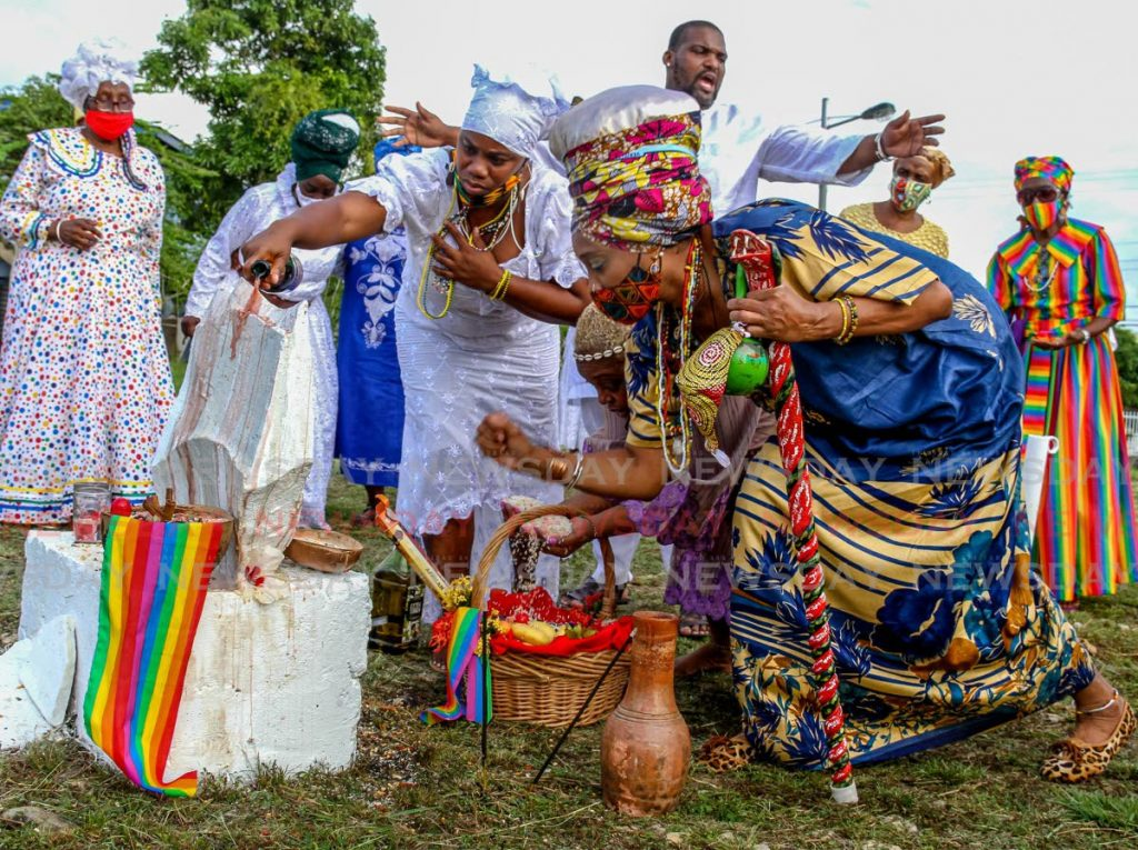 In this March 21, 2021 file photo, Orisha followers pay homage to ancestors on ancestral grounds in Lopinot/Bon Air West during a day of prayer held by the National Council of Orisha Elders. - PHOTO BY AYANNA KINSALE