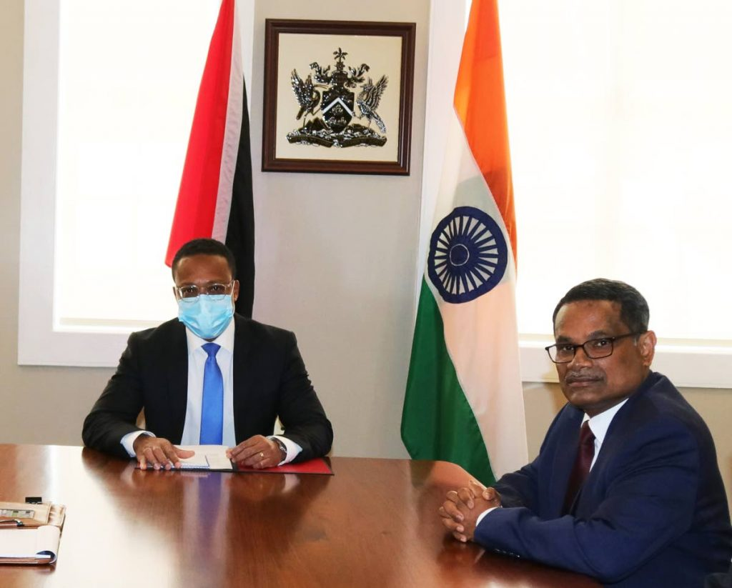 Foreign and Caricom Affairs Minister Dr Amery Browne, left, and India's High Commissioner to TT Arun Kumar Sahu during high-level diplomatic talks on March 21 at Browne's ministry office in St Clair. PHOTO COURTESY MINISTRY OF FOREIGN AND CARICOM AFFAIRS  -