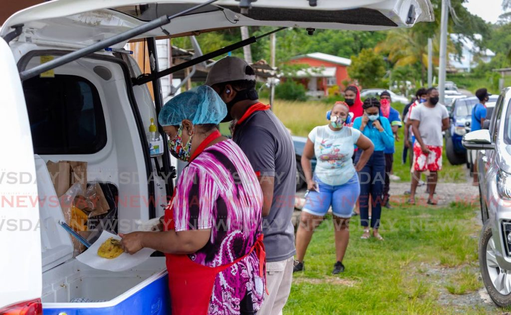 FILE PHOTO: Doubles lovers line up at Ravi's Doubles at Carnbee, Tobago. -