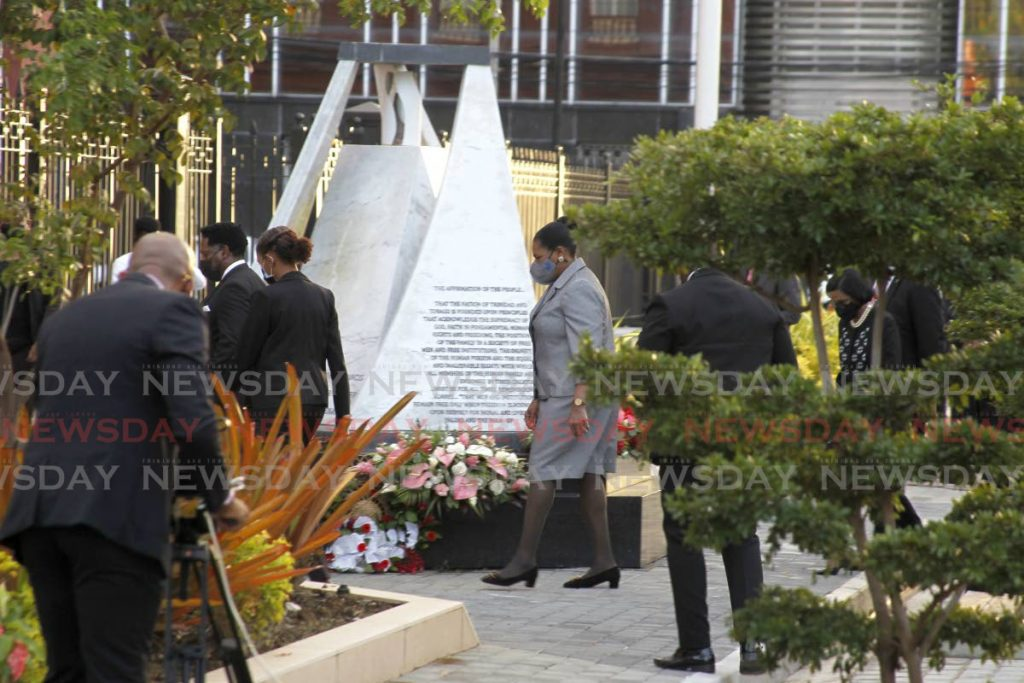 President Paula Mae Weekes attends a wreath laying ceremony at the Red House Port of Spain on Tuesday commerating those who died in the July 27, 1990 attempted coup. - PHOTO BY ROGER JACOB