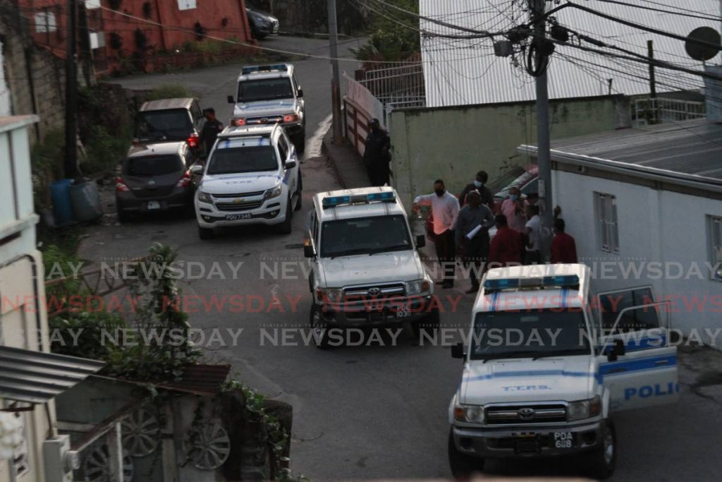 Police using video footage recreate the scene where three men were shot and killed by police on June 27, 2020 at Juman Drive, Second Caledonia, Morvant on July 29. - Photo by Marvin Hamilton