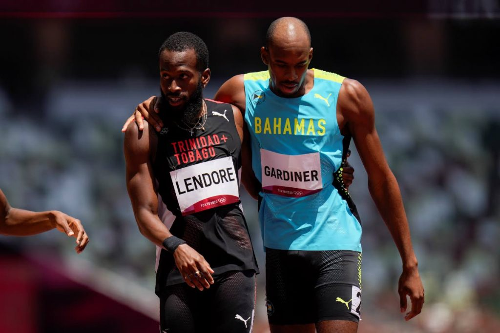 Deon Lendore, of Trinidad and Tobago (left), and Steven Gardiner, of Bahamas, react after a heat in the men's 400-metre run at the 2020 Summer Olympics, on Sunday, in Tokyo. (AP PHOTO) -