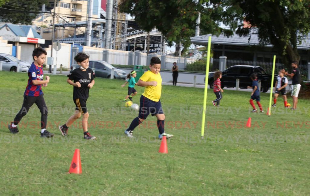 ON THE GREEN: Boys from Guerreros FC Soccer School practice football at Nelson Mandela Park, St Clair Avenue, Port of Spain on Monday. Photo by Sureash Cholai