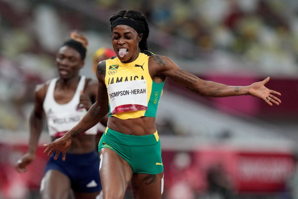 Elaine Thompson-Herah, of Jamaica, celebrates as she crosses the finish line to win the final of the women's 200 metres at the 2020 Summer Olympics, on Tuesday, in Tokyo. (AP PHOTO)