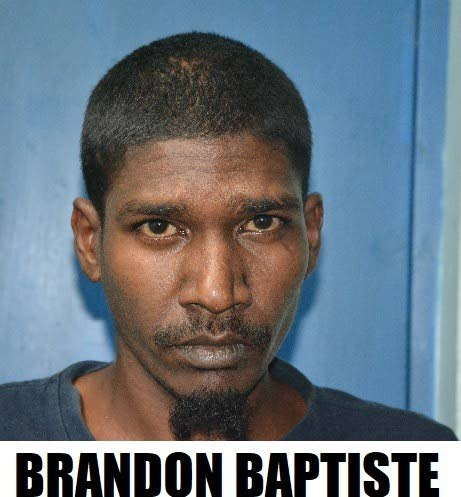 On Tuesday, Brandon Baptiste of Lonely Road, Indian Walk, was denied bail when he appeared before the Princes Town Magistrates Court on five fire-arm related charges.  - Photo courtesy TTPS
