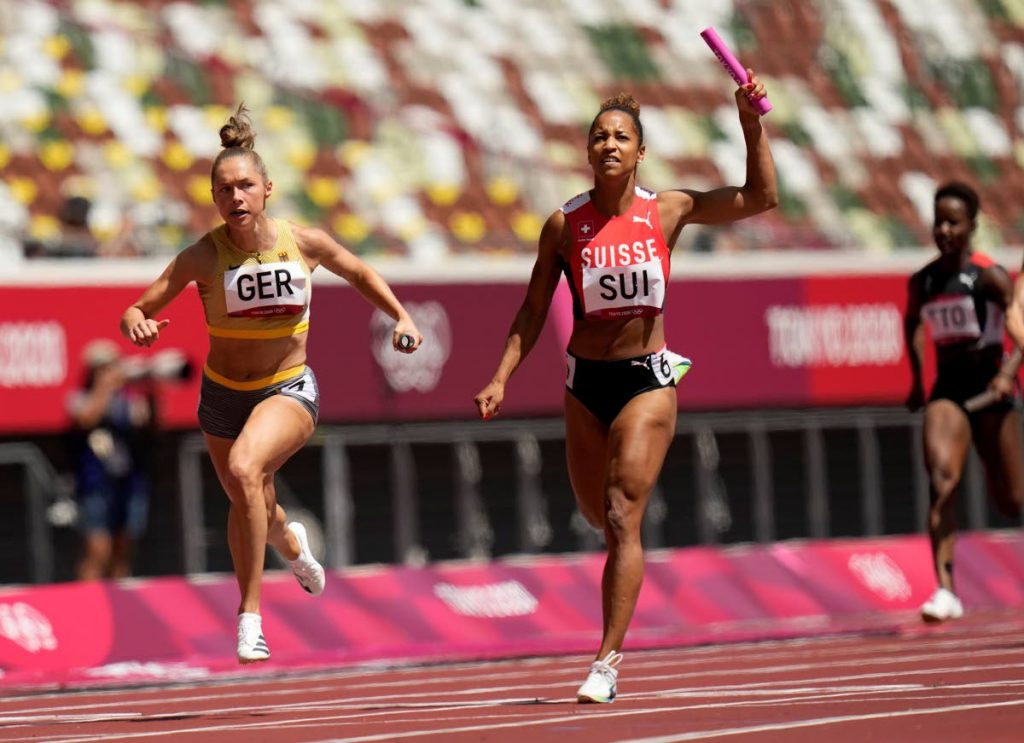 Gina Luckenkemper, of Germany (left), leads Salome Kora, of Switzerland (centre) in a semifinal of the women's 4x100-metre relay at the 2020 Summer Olympics, on Thursday (Wednesday night TT time), in Tokyo, Japan. Also in photo is TT sprinter Kelly-Ann Baptiste (right). (AP PHOTO) -