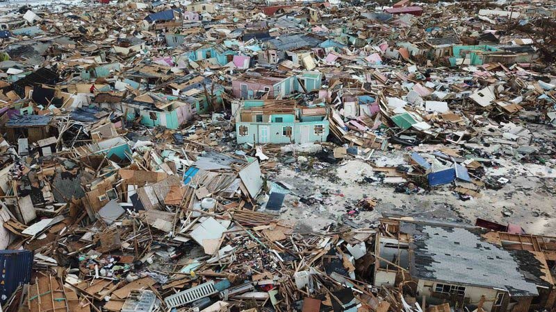 """Houses flattened by Hurricane Dorian in Abaco Island of Bahamas in 2019. The island was submerged by the water being dumped. The infrastructure of the island was wiped out. Seventy lives were lost, and to this day, over 200 people are still """"missing."""" (AP Photo) -"""