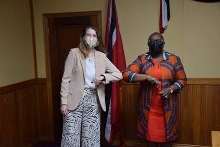 British High Commission Harriet Cross, left, and Minister of Planning and Development Camille Robinson-Regis, touch elbows during a recent meeting to discuss UK-TT relations.  -