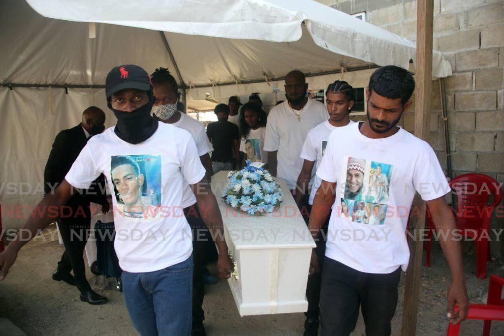 Pallbearers carry the casket of Ryan Sookraj, one of the five men shot dead last Saturday of Race Course Road in Carapo. Photo by Sureash Cholai.