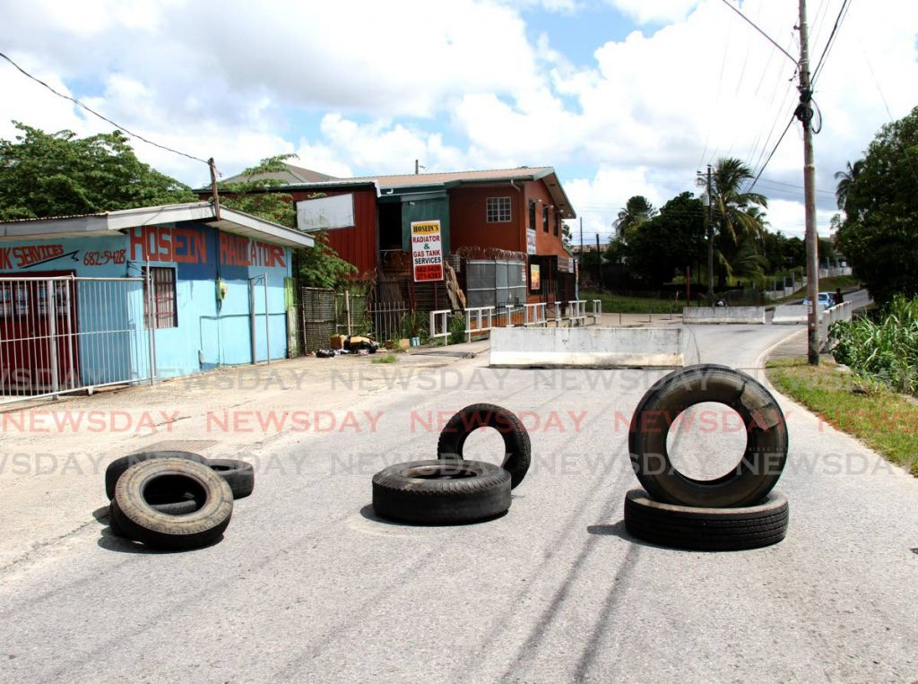 Barriers and tyres have been placed on either end of a bridge on O'Meara Road, Arima. The bridge has been deemed unsafe and, as a result, blocked to vehicular traffic by officials of the Ministry of Works and Transport. - AYANNA KINSALE