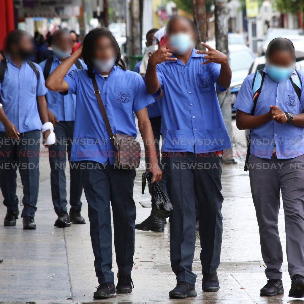 File photo: Secondary schoolboys in Port of Spain. Their faces are blurred to protect their identities.