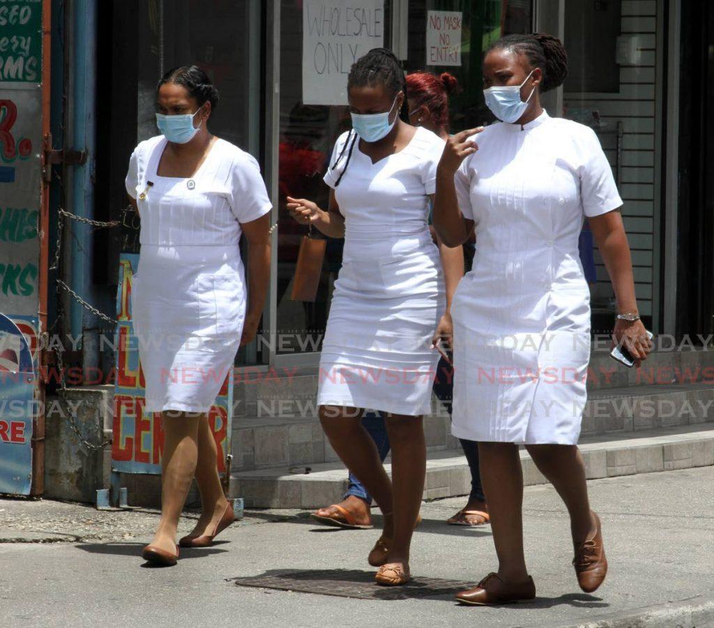 Nurses at Main Road, Chaguanas in September last year. (FILE PHOTO) -