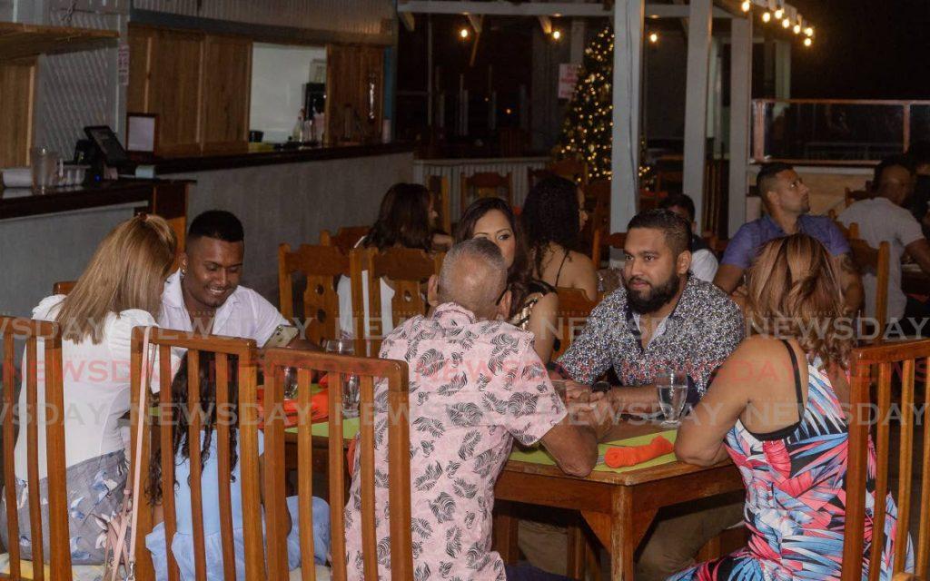 FILE PHOTO: Customers dine at Waves restaurant, Grafton Beach. -