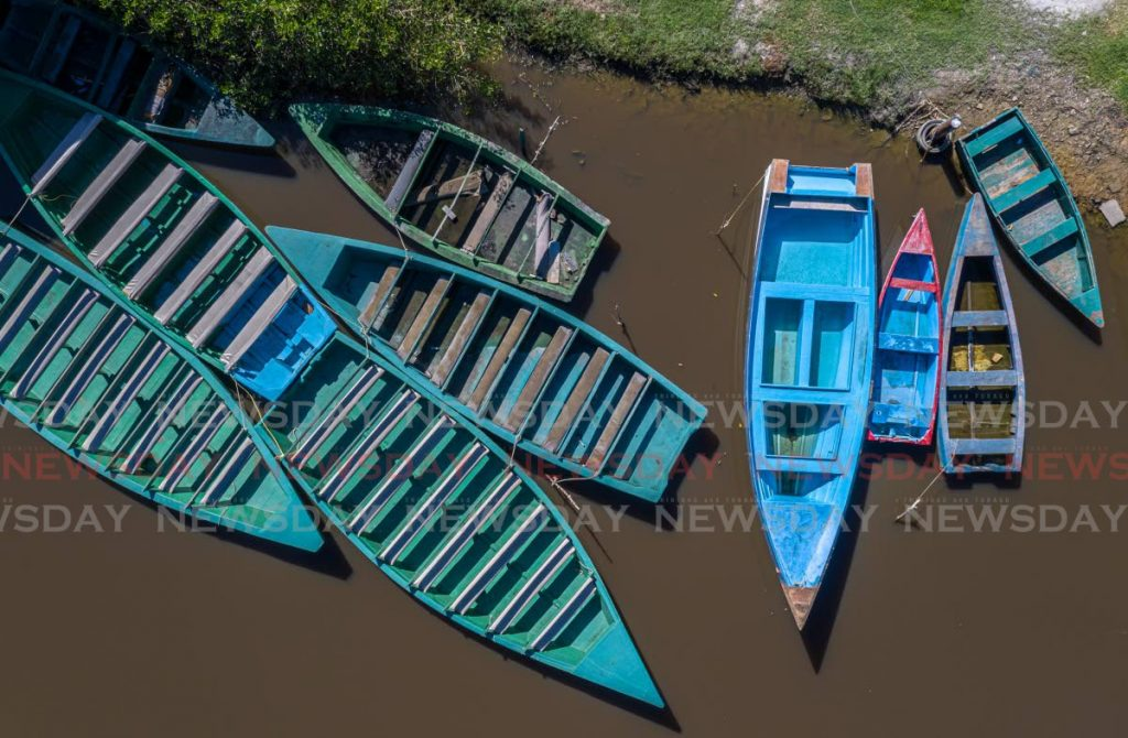 Tour boats at the Caroni Swamp remain on the dock as recreational places are still closed. - Photo by Jeff K. Mayers